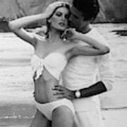Rene Russo Posing With A Male Model On A Beach Art Print
