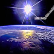 Robot Arm Over Earth With Sunburst  Art Print