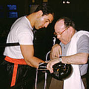Rocky Marciano Looking At Glove Print by Retro Images Archive
