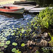 Rowboat At Lake Shore At Dusk Print by Elena Elisseeva