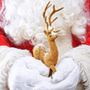Santa Holding Reindeer Figure Art Print