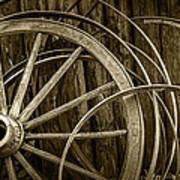 Sepia Photo Of Broken Wagon Wheel And Rims Art Print