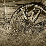 Sepia Toned Photo Of An Old Broken Wheel Of A Farm Wagon Art Print