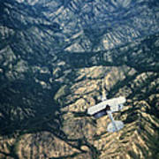 Small Plane Flying Over Mountains Art Print