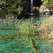 Small Waterfall And An Emerald Colored Lake Art Print
