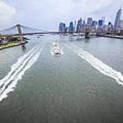 Speed Boats And Barge At East River In Front Of The Brooklyn Bridge And Manhattan Skyline Art Print