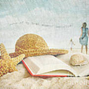 Straw Hat And Book In The Sand Art Print by Sandra Cunningham