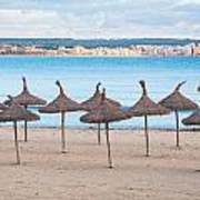 Straw Umbrellas On Empty Beach Art Print