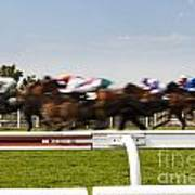 The Blur Of Racehorses Racing By The Rails On A Race Track  Art Print