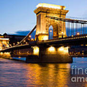 The Chain Bridge In Budapest Lit By The Street Lights Art Print