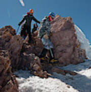 Three People Climb Down Rocks Art Print