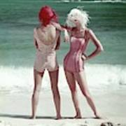 Two Models Standing On A Beach Art Print