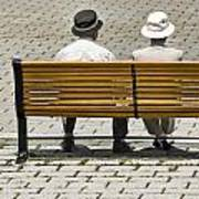 Two People Seated On A Bench Art Print