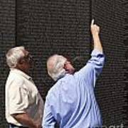 Veterans Look For A Fallen Soldier's Name On The Vietnam War Memorial Wall Art Print