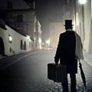 Victorian Man With Top Hat Carrying A Suitcase Walking In The Old Town At Night Art Print