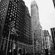 view of pennsylvania bldg nelson tower and US flags flying on 34th street from 1 penn plaza Art Print by Joe Fox