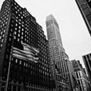 view of pennsylvania bldg nelson tower and US flags flying on 34th street from 1 penn plaza nyc Print by Joe Fox