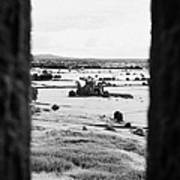 viewpoint looking out through stone fortifications towards hore abbey from the Rock of Cashe Art Print