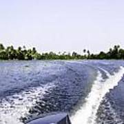 Wake From The Wash Of An Outboard Motor Boat In A Lagoon Art Print