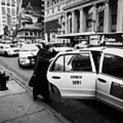 white middle aged passengers exit from yellow cab rear door at taxi rank on 7th Avenue Art Print