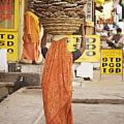 Woman Carrying Cow Dung In Basket On Art Print by Paul Miles