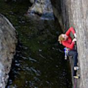 Woman Climbing Above A River Art Print