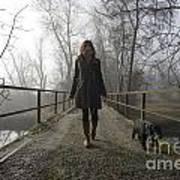 Woman Walking With Her Dog On A Bridge Art Print