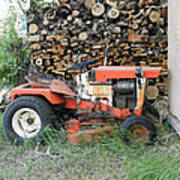 Wood Pile And Lawn Tractor Art Print