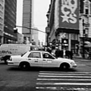 yellow cab taxi blurs past pedestrian waiting at crosswalk on Broadway outside macys new york usa Art Print