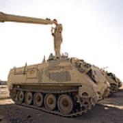 A Us Army Mechanic Uses A M113 Art Print