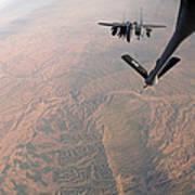 An F-15e Strike Eagle Is Refueled Art Print