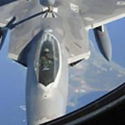 An F-22 Raptor Receives Fuel Art Print
