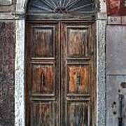 an old wooden door in Italy Art Print by Joana Kruse