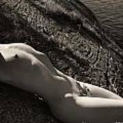 Nude Woman Lying On Rocks By The Water Art Print