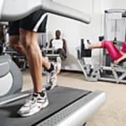 People Exercising In Health Club Art Print