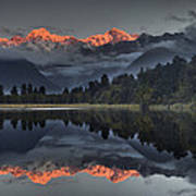 Sunset Reflection Of Lake Matheson Print by Colin Monteath