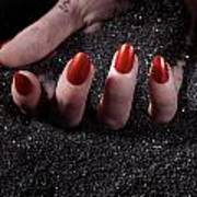 Woman Hand With Red Nails On Black Sand Art Print
