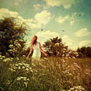 Young Girl Walking In Field Of Flowers Art Print