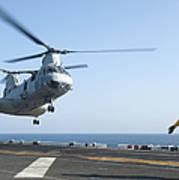A Ch-46e Sea Knight Helicopter Prepares Art Print