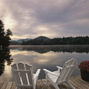 A Pair Of Adirondack Chairs On A Dock Art Print