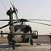 A Uh-60 Black Hawk Helicopter Parked Art Print