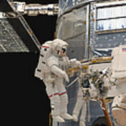 Astronauts Working On The Hubble Space Art Print