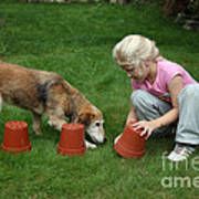 Girl Playing With Dog Print by Mark Taylor