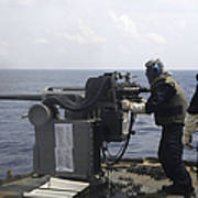 Gunner Fires A Mark 38 Machine Gun Art Print