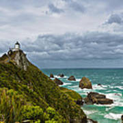 Nugget Point Light House And Dark Clouds In The Sky Art Print