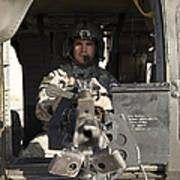 A Uh-60 Black Hawk Door Gunner Manning Art Print