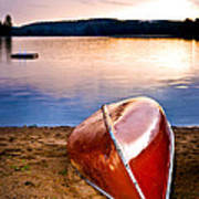 Lake Sunset With Canoe On Beach Art Print