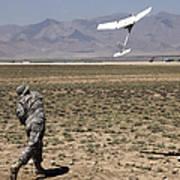 U.s. Army Soldier Launches An Rq-11 Art Print