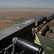 A .50 Caliber Machine Gun Points Art Print by Stocktrek Images