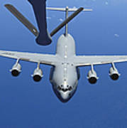 A C-17 Globemaster IIi Approaches Art Print by Stocktrek Images